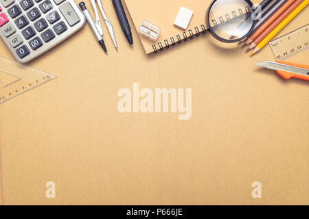 Overhead Shot Of School Supplies On Brown Craft Paper Background