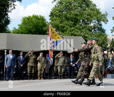 A color guard marches with the European Union Forces flag during a ceremony to recognize EU Day at Army Hall in Sarajevo, Bosnia and Herzegovina, May 9, 2016. The purpose of the ceremony was to publicly and jointly remember the important role that EUFOR plays in support of BiH as well as commemorate all those who lost their lives while supporting the collective stability for a peaceful future. - Stock Photo