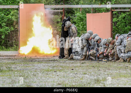 Engineers assigned to the 37th Brigade Engineer Battalion, 2nd Brigade Combat Team, 82nd Airborne Division demonstrate door-breaching techniques during the battalion's Sapper Stakes Competition on Fort Pickett, Va., May 7, 2016. The 37th BEB, alongside their Army Total Force partners, the 116th Brigade Special Troops Battalion, 116th Infantry Brigade Combat Team, have been training at Fort Pickett for several weeks to maintain contingency response mission skills and culminated the exercise with a daylong competition to single out the best engineer squad. (82nd Airborne Division photo by Staff  - Stock Photo