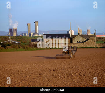 Farming in Beckermet, Cumbria. Sellafield nuclear power plant in the backgound. NW England - Stock Photo