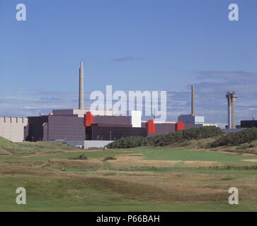 BNFL's THORP reprocessing plant, Sellafield, Cumbria, UK. Seascale golf course in foreground - Stock Photo
