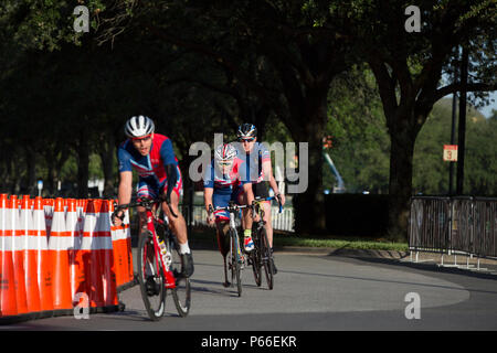 Cyclists competing in the 2016 Invictus Games warm up on a road near the ESPN Wide World of Sports Complex, Orlando, Fla., May 9.2016. The Invictus Games are an adaptive sports competition which was created by Prince Harry of the United Kingdom after he was inspired by the DoD Warrior Games. This event brings together wounded, ill, and injured service members and veterans from 15 nations for events including: archery, cycling, indoor rowing, powerlifting, sitting volleyball, swimming, track and field, wheelchair basketball, wheelchair racing, wheelchair rugby and wheelchair tennis. 115 U.S. at - Stock Photo