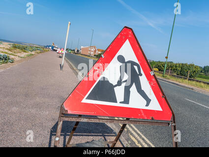 Triangular portable roadworks sign in the UK. - Stock Photo