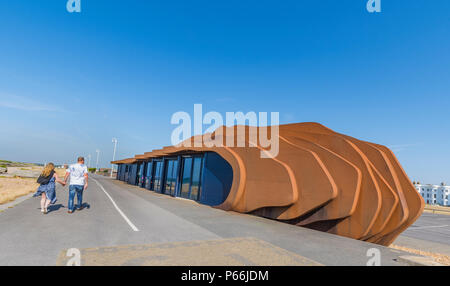People walking on the promenade past the East Beach Cafe in Summer in Littlehampton, West Sussex, England UK. - Stock Photo