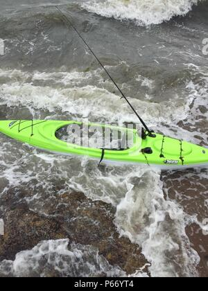NEW YORK – Crews from the Coast Guard and local agencies are searching for a possible missing person after an unmanned kayak was located near the rocks at Lighthouse Point in New Haven, Connecticut, May 15, 2015. At approximately 12:30 p.m. May 15, watchstanders at Coast Guard Sector Long Island Sound received a call from a good Samaritan reporting an unmanned bright green, one-person kayak drifting onto the rocks at Lighthouse Point. (U.S. Coast Guard Photo) - Stock Photo