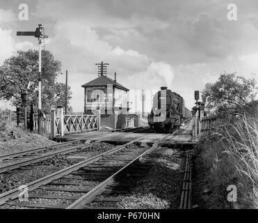 The location is Whissendine, between Melton Mowbray and Oakham on the Leicester to Peterborough line. The signalman in the MR box watches the photogra - Stock Photo