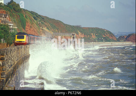 A Virgin Trains HST encounters high seas on the Dawlish sea wall as  it heads for Penzance. 2001 - Stock Photo