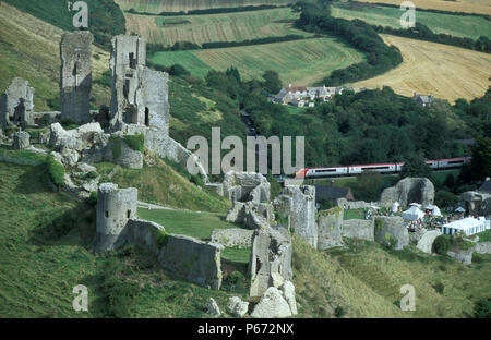 A Virgin Voyager runs in the shadow of Corfe Castle with a special service on the Swanage Railway. 8th September 2002 - Stock Photo