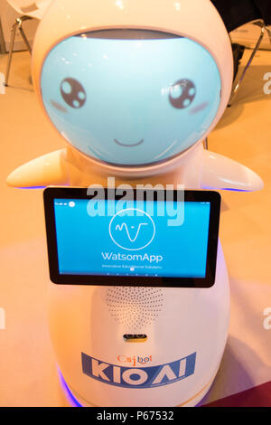 Snow robot (emotional and companion droid) from Csjbot company, smiling. In GR-EX (Global Robot Expo), International and European summit in robotics. - Stock Photo