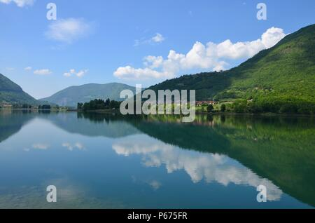 Lago d'Iseo in Lombardy in Italy, sea view, tourism, water surface, lake, summer, blue sky, boat rides, clouds, hills, climbing, hiking trails, sun - Stock Photo