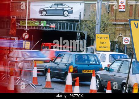 Vehicles negotiating traffic management at road works adjacent to Vauxhall station. London, United Kingdom. - Stock Photo
