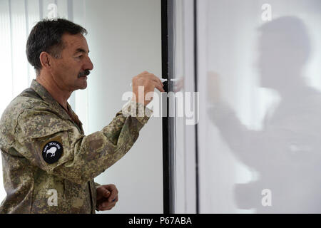 160525-N-GI544-091 PANCHKHAL, Nepal (May 25, 2016) – Maj. Jim Josephs, assigned to J5-H Joint Operational Health Group, New Zealand Defense Force, writes and presents information during a seminar on force health protection in peacekeeping operations between the U.S., New Zealand, Nepalese and Bangladeshi military medical professionals at the Birendra Peace Operations Training Center in Panchkhal, Nepal.  The seminar was formed to enhance force medicine practices within the U.S. military as well as share and collaborate with partner nations across the Indo-Asia-Pacific region. (U.S. Navy photo