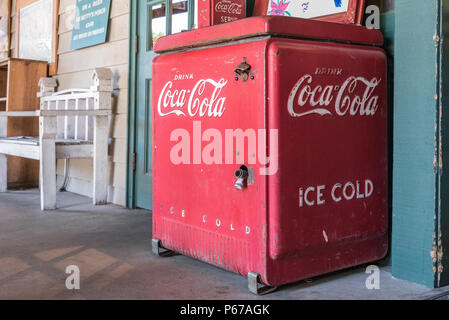 Vintage Ice Cold Coca-Cola cooler on the front porch of Betty's Country Store in the Blue Ridge Mountains at Helen, Georgia. (USA) - Stock Photo