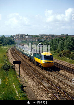 Bristol. The 10.35 service from Weston-Super-Mare to London heads out of Bristol with the Brunel College in the background. 12th June 1983. - Stock Photo