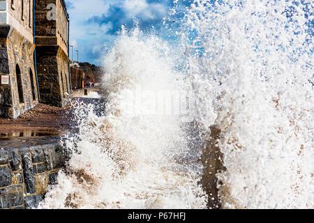 Waves crashing onto the sea wall at Dawlish in Devon, UK. - Stock Photo