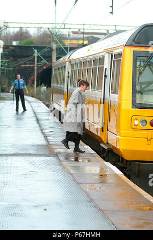 The Merseyrail services operating out of Liverpool Lime St extend beyond the Mersey area including this Liverpool-Manchester Victoria working seen pic - Stock Photo