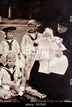 Royal Family portrait shows Queen Victoria with her 4 grandchildren. Princess Mary is shown wearing a hat, to her right is Prince Edward, Prince Albert is seated at the front and the newborn, Prince Henry is in Victoria's arms. - Stock Photo