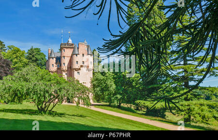 CRAIGIEVAR CASTLE ABERDEENSHIRE SCOTLAND MAIN ENTRANCE PEOPLE AT THE TOP OF THE TOWER AND VARIETY OF TREES - Stock Photo
