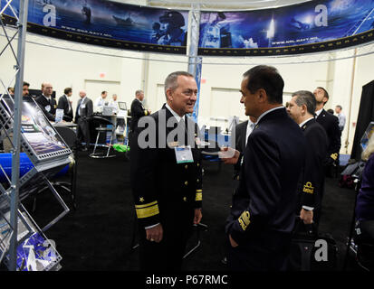 160516-N-PO203-210  NATIONAL HARBOR, Md. (May. 16, 2016) Rear Adm. Mat Winter, left, chief of naval research, talks with Vice Adm. Osvaldo Brogi, chief of general office, Italy, during a visit to the the Office of Naval Research (ONR) exhibit as part of the 2016 Sea-Air-Space Exposition. Sea-Air-Space is hosted by the Navy League of the United States with the goal of bringing together leaders from defense organizations, both government and private industry, to learn about and view the most up-to-date information and technology related to maritime policy. (U.S. Navy photo by John F. Williams/Re - Stock Photo
