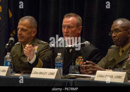 160516-N-XO220-055  NATIONAL HARBOR, Md. (May 16, 2016) Rear Adm. Thomas Shannon, commander, Military Sealift Command, speaks during a naval integration roundtable during the 2016 Sea-Air-Space Exposition. The Sea-Air-Space Exposition is an annual event that brings together key military decision makers, the U.S. defense industrial base and private-sector U.S. companies for an innovative and educational maritime based event. (Mass Communication Specialist 3rd Eric S. Brann/Released) - Stock Photo