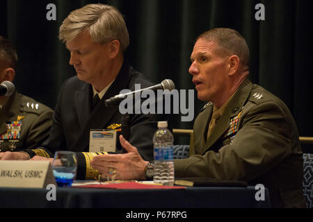 160516-N-XO220-066 NATIONAL HARBOR, Md. (May 16, 2016) – Lt. Gen. Robert Walsh, commanding general of the Marine Corps Combat Development Command, speaks during a naval integration roundtable during the 2016 Sea-Air-Space Exposition. The Sea-Air-Space Exposition is an annual event that brings together key military decision makers, the U.S. defense industrial base and private-sector U.S. companies for an innovative and educational maritime based event. (Mass Communication Specialist 3rd Eric S. Brann/Released) - Stock Photo