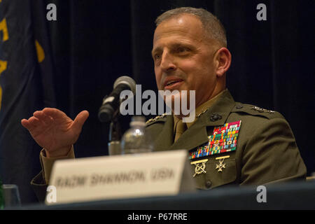 160516-N-XO220-036 NATIONAL HARBOR, Md. (May 16, 2016) – Lt. Gen. Michael Dana, deputy commandant for installations and logistics, speaks during a naval integration roundtable during the 2016 Sea-Air-Space Exposition. The Sea-Air-Space Exposition is an annual event that brings together key military decision makers, the U.S. defense industrial base and private-sector U.S. companies for an innovative and educational maritime based event. (Mass Communication Specialist 3rd Eric S. Brann/Released) - Stock Photo