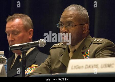 160516-N-XO220-023 NATIONAL HARBOR, Md. (May 16, 2016) – Lt. Gen. Ronald Bailey, deputy commandant for plans, policies and operations USMC, speaks during a naval integration roundtable during the 2016 Sea-Air-Space Exposition. The Sea-Air-Space Exposition is an annual event that brings together key military decision makers, the U.S. defense industrial base and private-sector U.S. companies for an innovative and educational maritime based event. (Mass Communication Specialist 3rd Eric S. Brann/Released) - Stock Photo