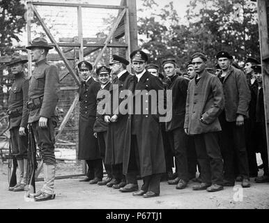 Photograph of the captured German officers and crew members of the U-58 submarine upon their entry into a POW camp at Fort McPherson, Georgia. Dated 1918 - Stock Photo