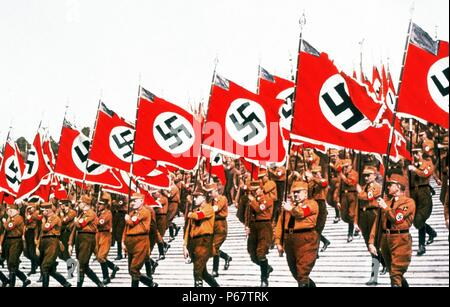 The entry of the colours at the German National Socialist Party Day at Nuremberg, 1933. The National Socialist German Workers' Party commonly known in English as the Nazi Party, was a political party in Germany active between 1920 and 1945. - Stock Photo
