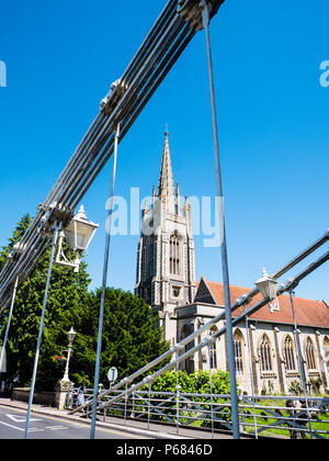 Marlow Bridge suspension bridge, Across River Thames Designed by William Tierney Clark, with All Saints Church, Marlow, Buckinghamshire, England, UK, - Stock Photo