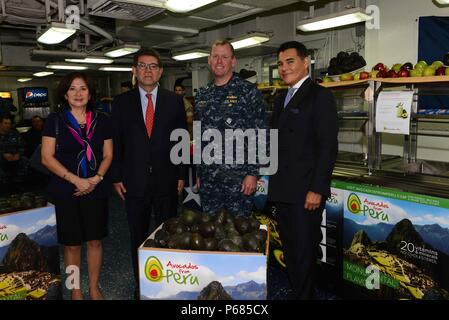 160527-N-YD083-081 NEW YORK (May 27, 2016) –  The Ambassador of Peru and his wife were joined by the Executive Officer of the USS Bataan Capt. Corey Keniston and the CEO of Avocados from Peru pose for a picture before exchanging gifts after eating a Superfood breakfast provided by Avocados from Peru, during 2016 Fleet Week New York (FWNY), May 27. FWNY, now in its 28th year, is the city's time-honored celebration of the sea services. It is an unparalleled opportunity for the citizens of New York and the surrounding tri-state area to meet Sailors, Marines and Coast Guardsmen, as well as witness - Stock Photo
