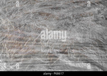 Texture of cellophane material with many folds and bends . - Stock Photo