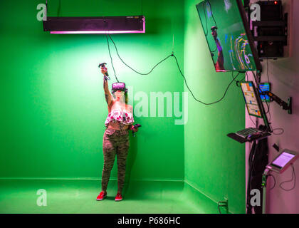 New York, USA, 28 June 2018.  A woman creates a drawing in a Virtual Reality center in New York City.  Photo by Enrique Shore - Stock Photo