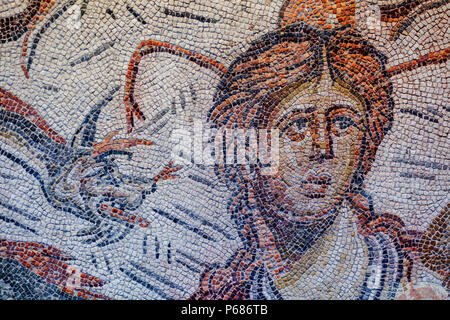 Jaen, Spain - December 29th, 2017: Roman Mosaic depicting sea-goddess Tethys at Jaen Museum. Fragment detail - Stock Photo