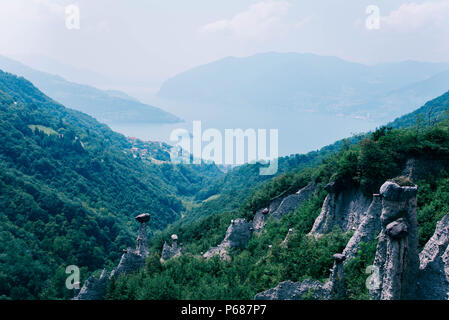 Beautiful view of Iseo Lake and the pyramids of Zone, Lombardia, Italy. - Stock Photo