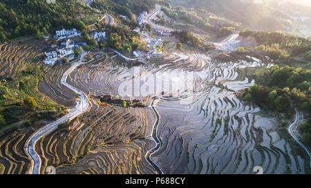 (180628) -- BEIJING, June 28, 2018 (Xinhua) -- Aerial photo taken on April 10, 2018 shows the bird's-eye view of terraced fields on the Wuyun Mountain in Qichun County of central China's Hubei Province. Comprehensive progress has been made since the report delivered at the 18th National Congress of the Communist Party of China (CPC) in 2012 included ecological development as a major task in the country's overall plan and proposed building a 'beautiful China' as a grand goal.  (Xinhua/Cheng Min) (wyo)(zt) - Stock Photo