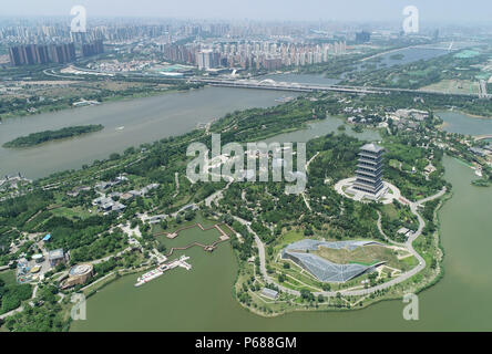 (180628) -- BEIJING, June 28, 2018 (Xinhua) -- Photo taken on June 21, 2018 shows the Xi'an Expo Park located within the Chanba Ecological District in Xi'an, northwest China's Shaanxi Province. Comprehensive progress has been made since the report delivered at the 18th National Congress of the Communist Party of China (CPC) in 2012 included ecological development as a major task in the country's overall plan and proposed building a 'beautiful China' as a grand goal.  (Xinhua/Shao Rui) (wyo)(zt) - Stock Photo