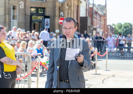 Warrington, UK. 29th June, 2018. The weather was hot and sunny for Warrington Walking Day. This annual religious event begins in front of the Town Hall and leraves through the famous golden gates with the procession following the closed streets and through the town centre Credit: John Hopkins/Alamy Live News - Stock Photo