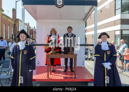 Warrington, UK. 29 June 2018 - The weather was hot and sunny for Warrington Walking Day. This annual religious event begins in front of the Town Hall and leraves through the famous golden gates with the procession following the closed streets and through the town centre Credit: John Hopkins/Alamy Live News - Stock Photo