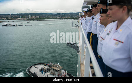 160518-N-QW941-208 PEARL HARBOR, Hawaii (May 18, 2016) Crew members aboard hospital ship USNS Mercy (T-AH 19) man the rails as the ship prepares to moor in Joint Base Pearl Harbor-Hickam. Deployed in support of Pacific Partnership 2016, Mercy's mission is designed to emphasize multilateral cooperation and building mutual trust in the Indo-Asia-Pacific. Medical, engineering and various other personnel embarked aboard Mercy will work side-by-side with host and partner nation counterparts, exchanging ideas, building best practices and relationships to ensure preparedness should disaster strike. ( - Stock Photo