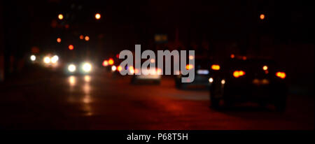 Artistic style - Defocused urban abstract texture, blurred background with bokeh of city lights from car on street at night, vintage or retro color to - Stock Photo