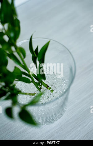Hydrogel, used in floristry, replaces the flowers with water. White in a glass vase. - Stock Photo