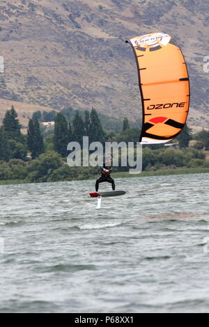 Fun on the water, this water sport of hydro kite boarding, on a lake in NZ an extream water activity for a sporting adventure holiday - Stock Photo