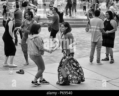 Couple dance at the Hola Carolina Festival, celebrating Latin American culture, inAsheville, NC, USA - Stock Photo
