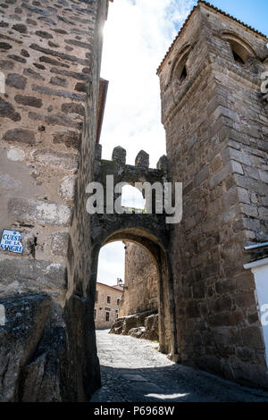 An arch of Puerta de Santiago in the narrow street in Trujillo, Extremadura, Spain - Stock Photo