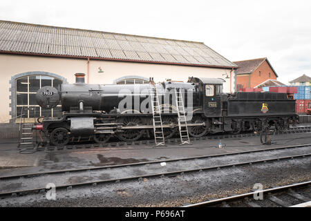 No 7822 Ex-GWR FOXCOTE MANOR undergoing maintenance at Minehead on the West Somerset Railway in the UK - Stock Photo