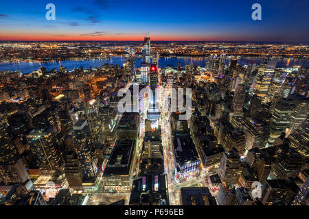New York City, NY, USA - Mach 11, 2018: Aerial view of Midtown West Manhattan with new Hudson Yards skyscrapers under contruction at twilight. - Stock Photo