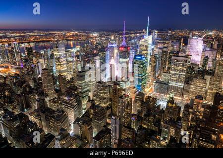 New York City, NY, USA - Mach 11, 2018: Midtown Manhattan skyscrapers illuminated at night (Times Square) - Stock Photo