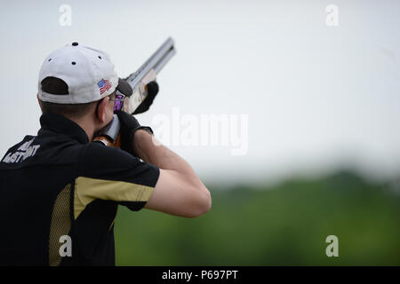 Army Skeet Team member, Maj  Carl Wojtaszek, performs skeet