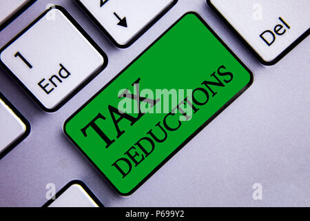 Text sign showing Tax Deductions. Conceptual photo Reduction on taxes Investment Savings Money Returns Text two words green insert button key press gr - Stock Photo